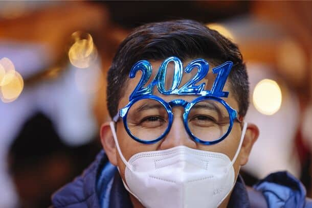 Person wearing fun glasses with 2021